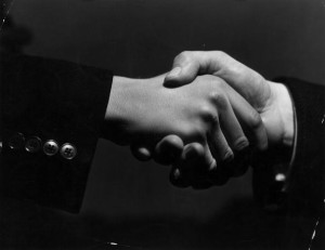 16th February 1938: A close-up of two hands grasping each other in a firm handshake. (Photo by Fox Photos/Getty Images)